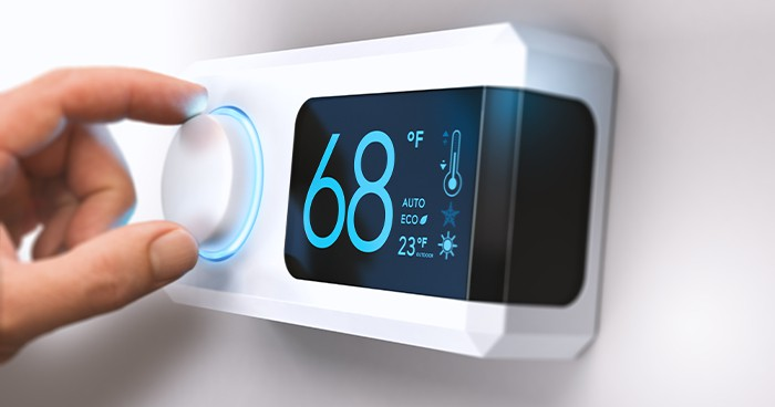 To save money on your utility bill, set your programmable or smart thermostat to approximately 68 degrees Fahrenheit.